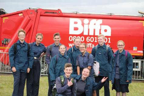 Squadron Photo at RAF Scampton Air Show in front of the large red craft.