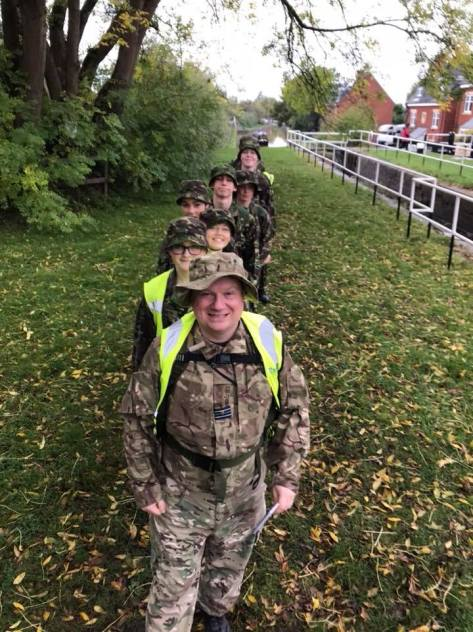 Flt Lt Adam Fowler leading the team at the Winter WARMA road march at Sandbach, Cheshire, in 2017. Sergeant Esther Taylor on camera duties.